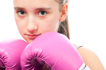 Portrait of pretty kick boxing girl with pink gloves