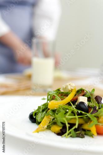 fresh Greek salad on white plate Poster