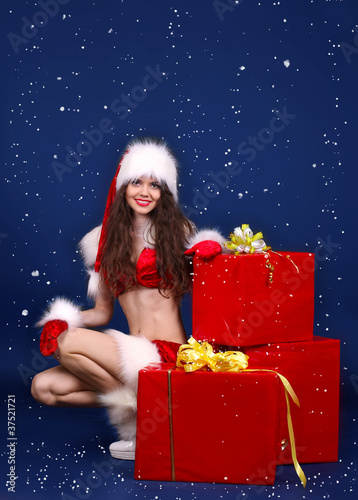 Girl present gift in Santa Claus clothes