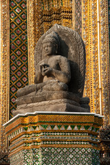Stone ancient Buddha in Wat Prakrew temple in Thailand.