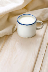 Breakfast with milk. Milk in vintage cup on old wooden table
