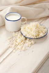 Breakfast with milk and cottage cheese on old wooden table