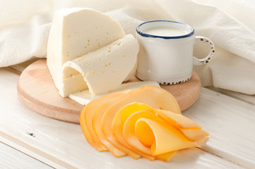Breakfast with milk and cheese on old wooden table