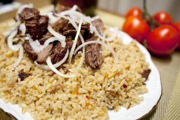 homemade traditional Uzbek pilaf served on a plate