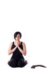 woman sit in yoga meditation pose pray with beads