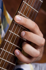 Really great shot capturing detail of a guitarist