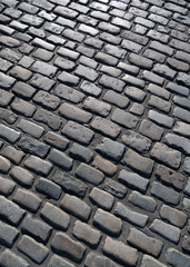 Old English cobblestone road in Plymouth close up.