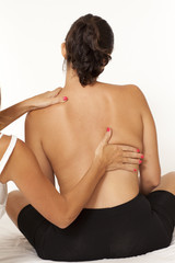 Massage of back on white background