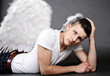Christmas: handsome, masculine, serious-looking angel
