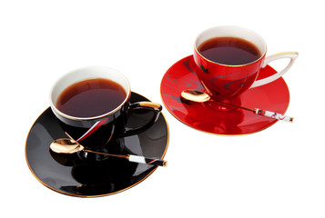 two cups of tea isolated over a white background