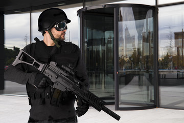Defense companies, armed police wearing bulletproof vests