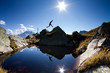 silhouette of jump on top of mountain