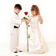 Little bride and groom with big rose flower