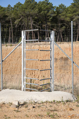 Frontal view of one-way deer gate