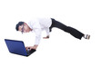 Businessman breakdancing while using laptop