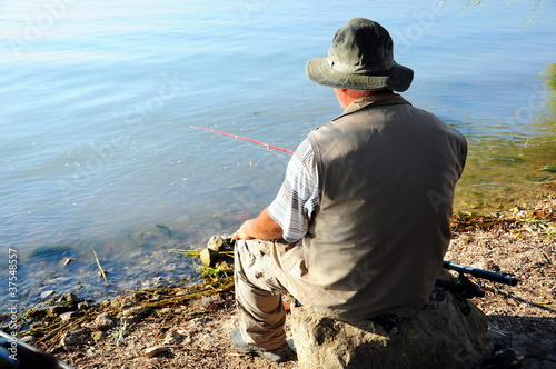 fisherman by lake