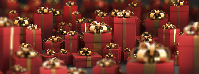 Beautiful red gift boxes with gold ribbon