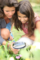 Girls looking through magnifying glass