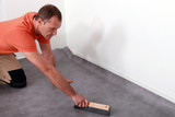 Man fitting a lino floor