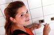 Young woman wiring a plug socket