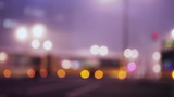 Defocused city lights at intersection poster