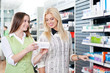 Female Pharmacist Advising Customer