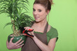 Young woman with a houseplant