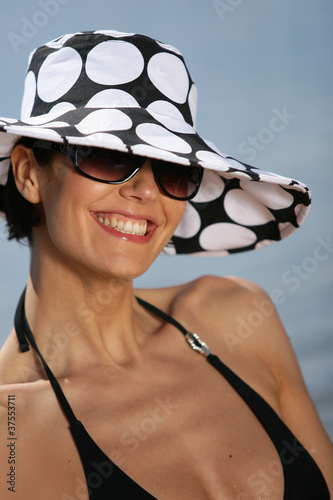Brunette wearing polka dot hat