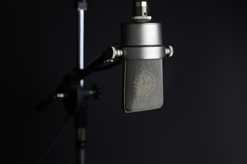 Studio microphone on grey background
