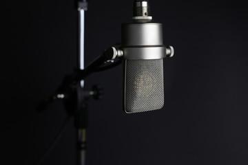 Studio microphone on grey background