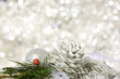 Winter holiday background with silver ornaments