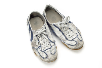 Old worn sports shoes