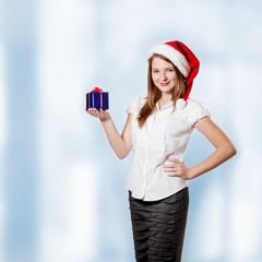 Young attractive woman holds christmas gift