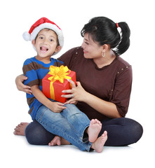 boy in Santa Claus hat and his mom