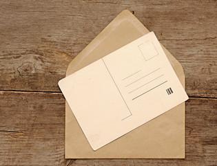 Blank vintage postcard and envelope