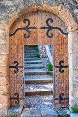 Old open wooden door with stairs