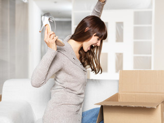 Young Woman opening her mail order / parcel