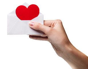 woman's hand holding an envelope with a sign of the heart isolat