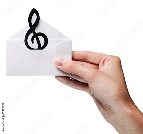 woman's hand holding an envelope with a sign of the melody isola