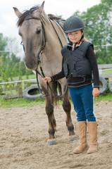 Little jockey - girl and horse ranch
