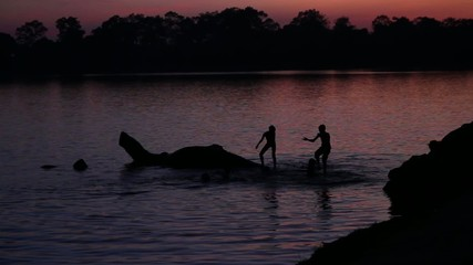 Children playing in the sunset