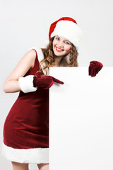Female santa holding a christmas white card