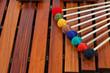 Leinwanddruck Bild - Coloured mallets on marimba
