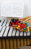 Marimba with coloured mallets and musical notes