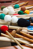 Pile of coloured mallets and sticks