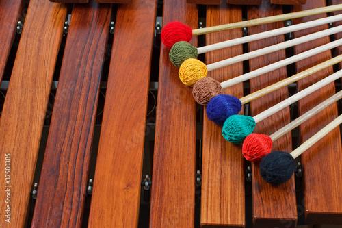 Leinwanddruck Bild Coloured mallets on marimba