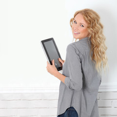 Beautiful modern woman using digital tablet