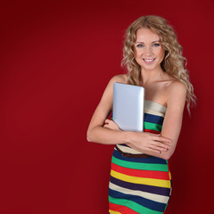 Smiling woman holding electronic tablet