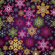 Seamless background with colorful snowflakes