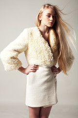 Blond woman in fashion coat with long hair